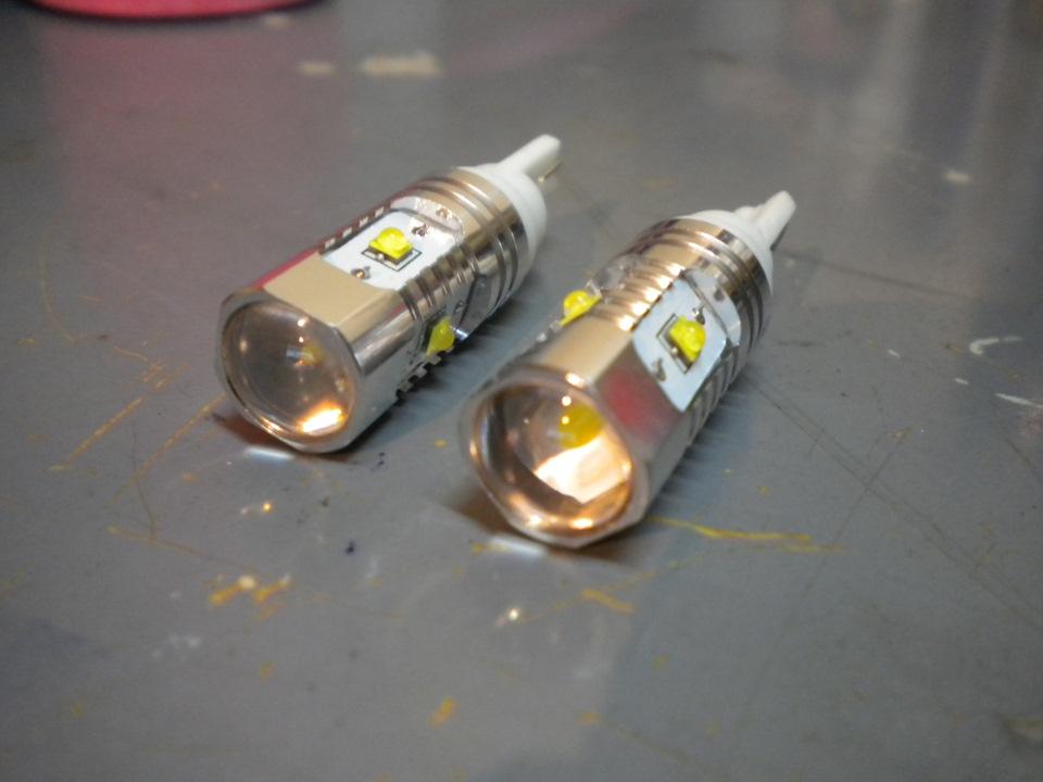 Как поменять лампочки в габаритах рено логан
