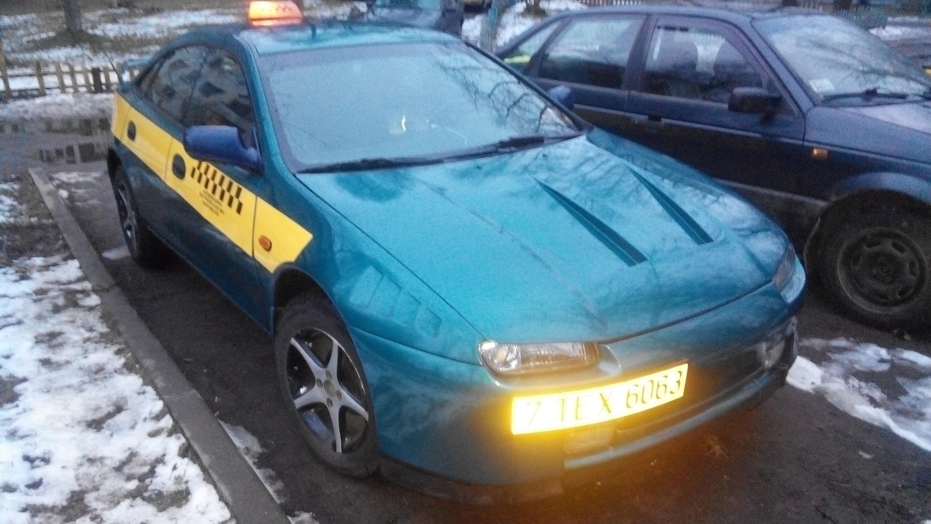 mazda 323 f в такси