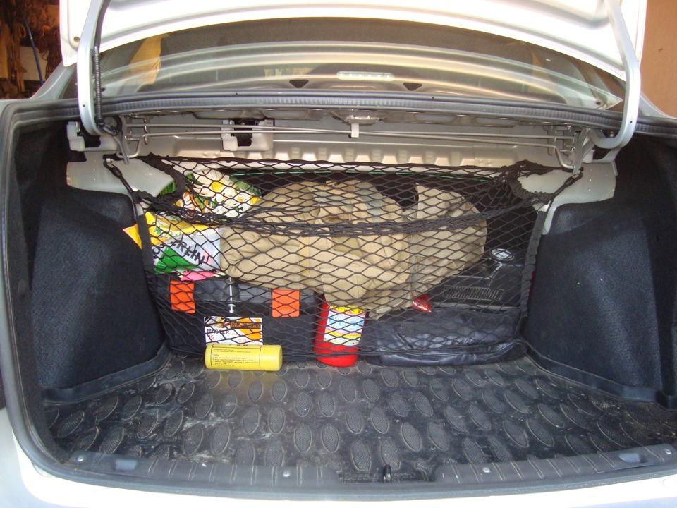 сетка в багажнике гранты
