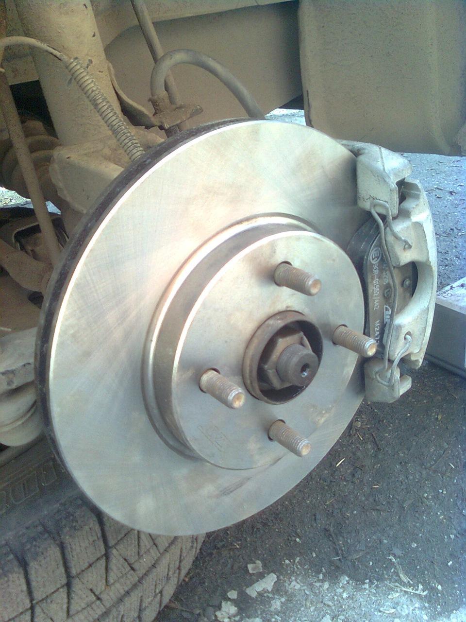 тормозной диск mazda demio 2003