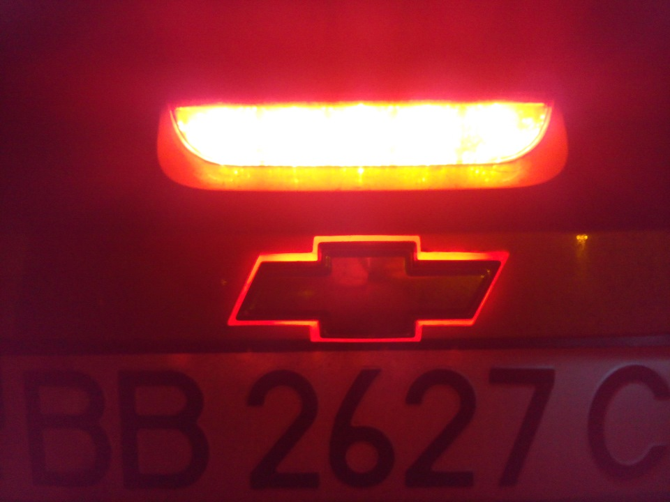 chevrolet lacetti значок красный треугольник