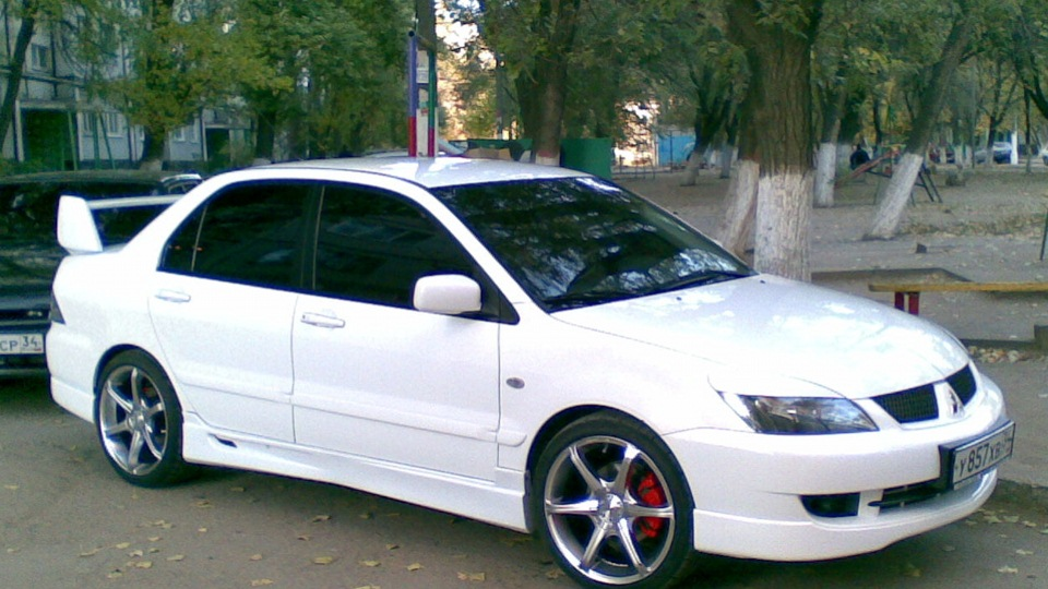 Mitsubishi Lancer white men DRIVE2