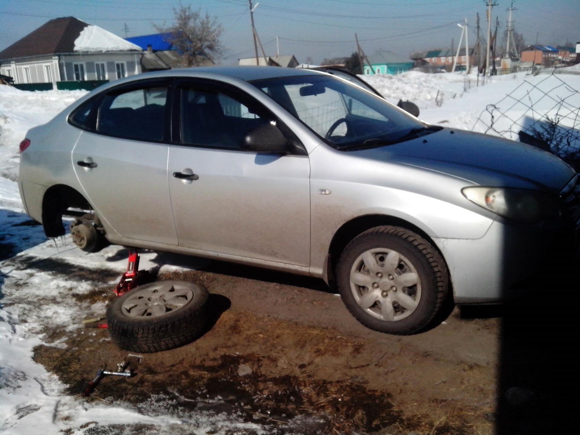 Hyundai Elantra: Parking Brake Adjustment