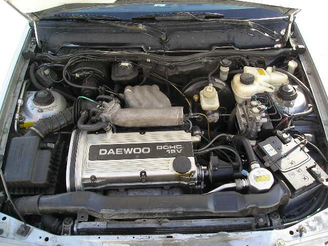 Minsk. вот фото двигателя моей Нексии с АБС, а бачек смортрите около моторчика вентилятора, а блок АБС...