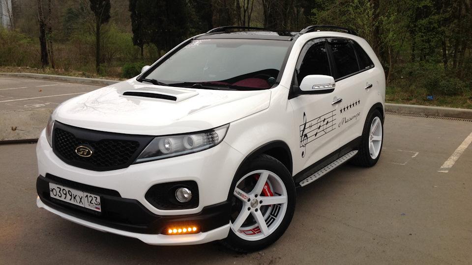 Kia sorento prime garage drive2 for Garage kia englos