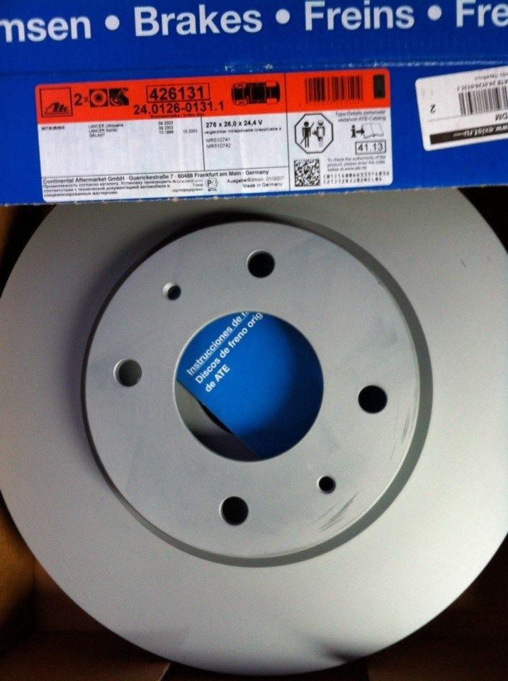 Номер оригинального переднего тормозного диска мицубиси лансер 9 4 дырки