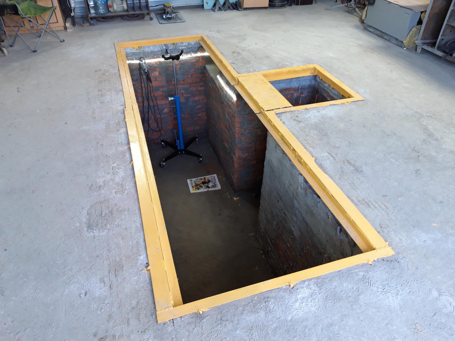 смотровая яма в гараже фото явился